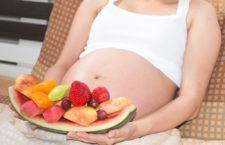 Portrait of asian pregnant women with fresh tasty sweet fruits decoration