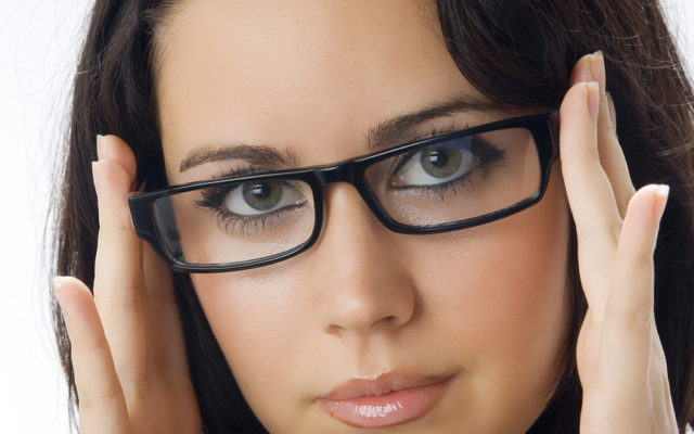 a nice portrait of young and really cute brunette with black glasses